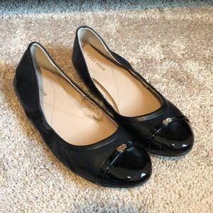 Cole Haan black leather ballet flat.
